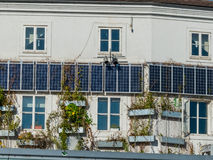 Solar panels on a house. Solar cells for use of solar energy on a residential house. alternative energy for townhouses Stock Photography