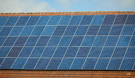 Solar panels on the house. Solar panels installed on a roof of a house Royalty Free Stock Images