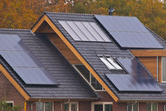 Solar panels on  house. Solar panels on newly build house Royalty Free Stock Image