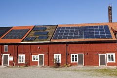 Solar panels on a house. Photovoltaic Solar Panels On The House Roof Against A Blue Sky Royalty Free Stock Images
