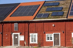 Solar panels on a house. Photovoltaic Solar Panels On The House Roof Against A Blue Sky Royalty Free Stock Photo