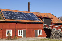 Solar panels on a house. Photovoltaic Solar Panels On The House Roof Against A Blue Sky Stock Photos