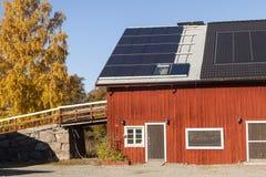 Solar panels on a house. Photovoltaic Solar Panels On The House Roof Against A Blue Sky Royalty Free Stock Photos