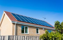 Solar Panels on House Roof Stock Images