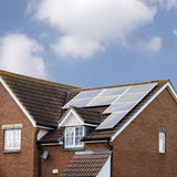 Solar Panels on House Roof. New house with eight solar panels on its roof Stock Image