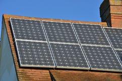 Solar Panels on House Roof. Solar Panels on suburban  House Roof Royalty Free Stock Photo