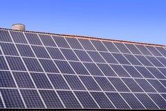 Solar panels on house roof. Alternative energy, solar panels on a house roof and clear sky Royalty Free Stock Photography