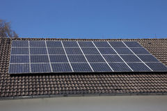 Solar panels on a house roof. An array of photovoltaic solar panels mounted on a house roof to supply renewable domestic electricity by converting the radiant Royalty Free Stock Photos