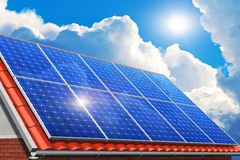 Solar panels on house roof. Creative solar power generation technology, alternative energy and environment protection ecology business concept: group of solar stock photo
