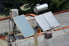 Solar Panels on a House Roof. Solar Energy Panels on the Roof of a House in Greece Stock Photography