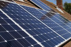 Solar panels on house roof. England. Solar panels for electricity generation on domestic house roof in Sussex. England Stock Photography
