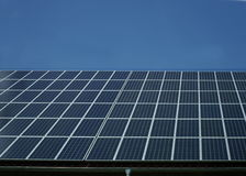 Solar panels on house roof Stock Photos