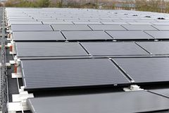 Solar panels on house rooftop. The Solar panels on house rooftop Stock Photography