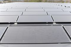 Solar panels on house rooftop. The Solar panels on house rooftop Stock Photo