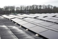 Solar panels on house rooftop. The Solar panels on house rooftop Stock Photos