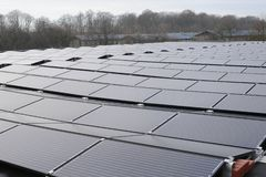 Solar panels on house rooftop. The Solar panels on house rooftop Royalty Free Stock Images
