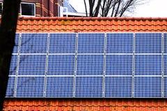 Solar panels house sky technology ecology alternative shaving economy old new roof tile cetamic encaustic. Red tile Roof with solar panels. New solar Stock Photo