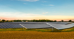 Solar Panels. Hundreds of solar panels occupying a number of fields across farmland creating a solar farm. Creating electricity which is fed into the national royalty free stock photo