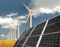 Solar Panels In Front Of Wind Energy Plants Stock Images
