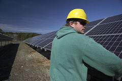 Solar panels inspected by workman Royalty Free Stock Photos