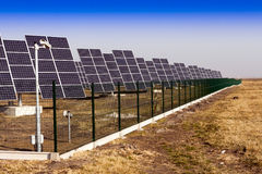Solar panels installed on the field. Stock Images