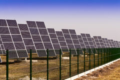 Solar panels installed on the field. Stock Photos