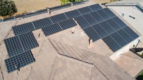 Solar Panels Installed on Roof of Large House Roof. Top stock photography