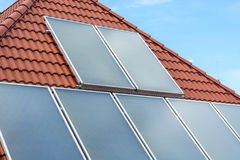 Solar panels installed on a roof. With the sky Royalty Free Stock Photo