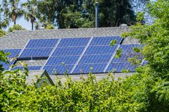 Solar panels installed on the rooftop of a house. San Jose, California stock photo