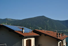 Solar panels in Italy. Restructured house with solar panels on the roof Stock Photo