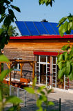 Solar panels on kindergarten roof Stock Image