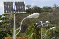 Solar panels and lights. Solar panel which permit to the street lamp to function royalty free stock photography