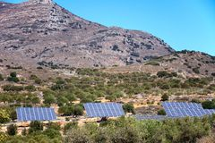 Solar panels in the mountains, Crete. Royalty Free Stock Photo