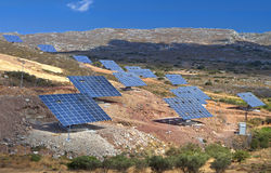 Solar panels mounted on a hillside Royalty Free Stock Image