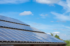 Solar panels mounted on a rooftop Royalty Free Stock Image