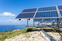 Solar panels near blue sea and monastery Royalty Free Stock Photography