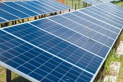 Solar panels near residential quarter of the city. Renewable solar energy stock image