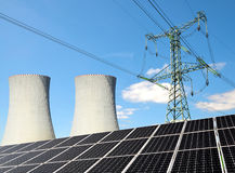 Solar panels, nuclear power plant and electricity pylon. Stock Photography