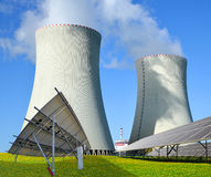 Solar panels and nuclear power plant. Stock Photo
