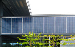 Solar panels on office building Stock Photos