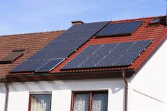 Solar panels. Old building energy re-manufacturing with solar panels Stock Photography