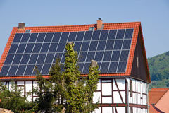 Solar panels on an old timbered house Royalty Free Stock Photography