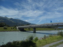 Solar panels on one of the border bridge Switzerland. And Liechtenstein with blue sky and Rhine River Stock Photos