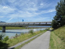 Solar panels on one of the border bridge Switzerland. And Liechtenstein with blue sky and Rhine River Stock Photo