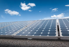 Solar panels over blue sky Royalty Free Stock Image