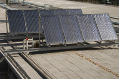 Solar panels over a building roof in Chamartin railway station. Stock Photos