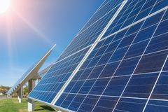 Solar panels or photovoltaic plant in front of a factory building. At a sunny day royalty free stock photos