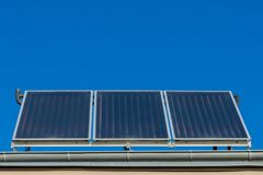 Solar panels or photovoltaic or solar thermal plant on the roof of a house royalty free stock images