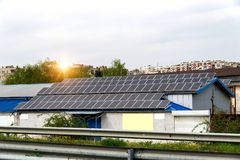 Solar panels, photovoltaics over the roof of an industrial building - alternative electricity source. Concept of sustainable resources royalty free stock photo