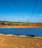 Solar panels and power lines Stock Image